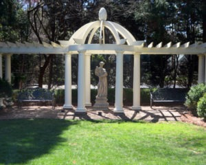 Springtime sculpture from Kenneth Lynch and Sons in Connecticut. The pergola, a gift from her children, was made in Charleston and sent to Charlotte.