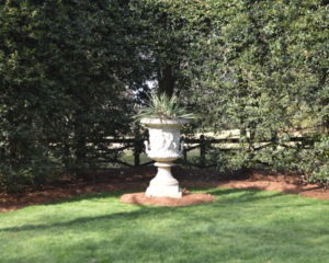 A gorgeous urn from Kenneth Lynch and Sons in Connecticut. Set on an axis with the pergola and sculpture at the other side of the garden.