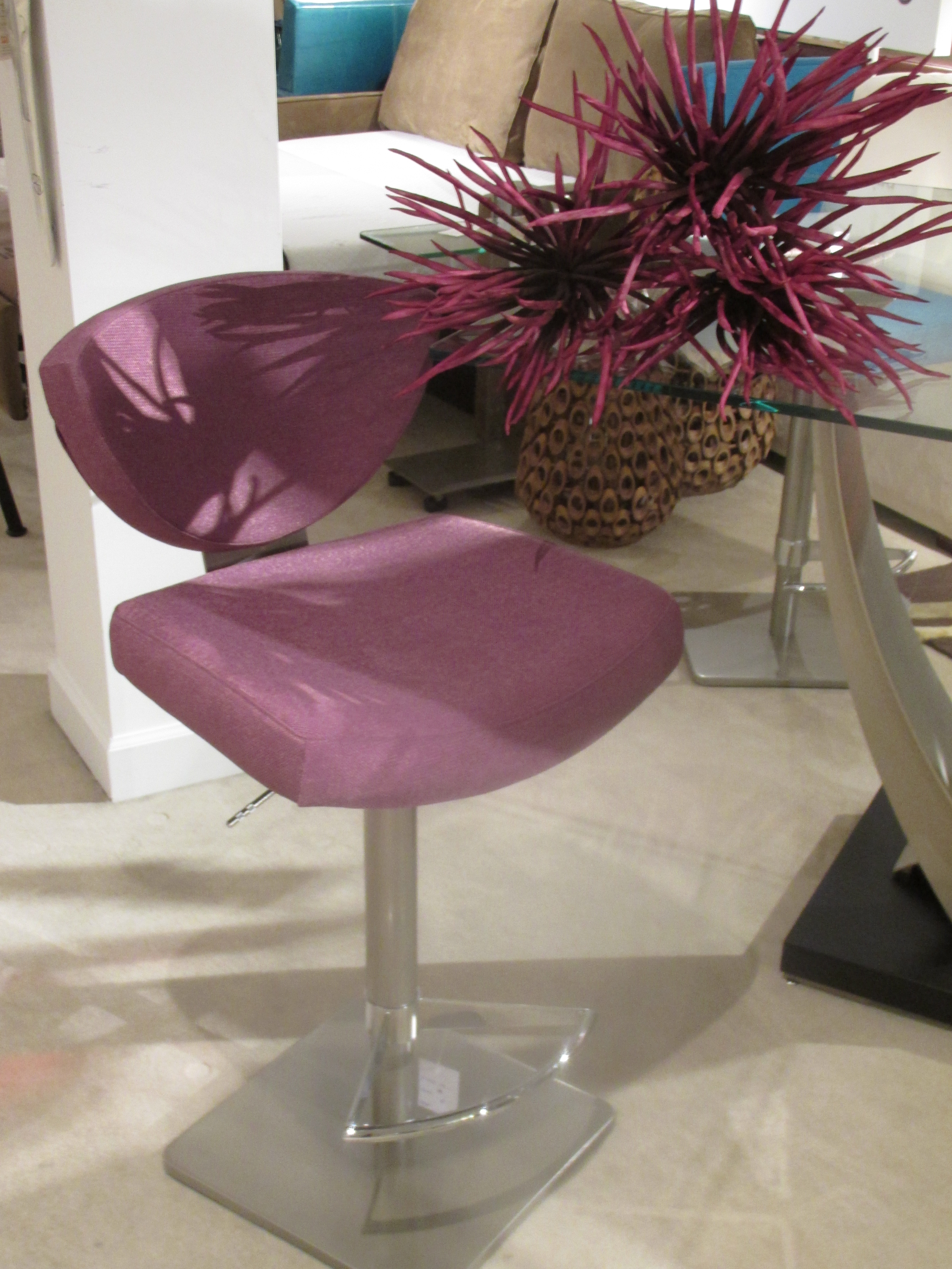 Add distinction to your kitchen or any casual dining area with sleek and stylish bar stools covered in this year's fresh fabric. Found at Reflections Home Furnishings.