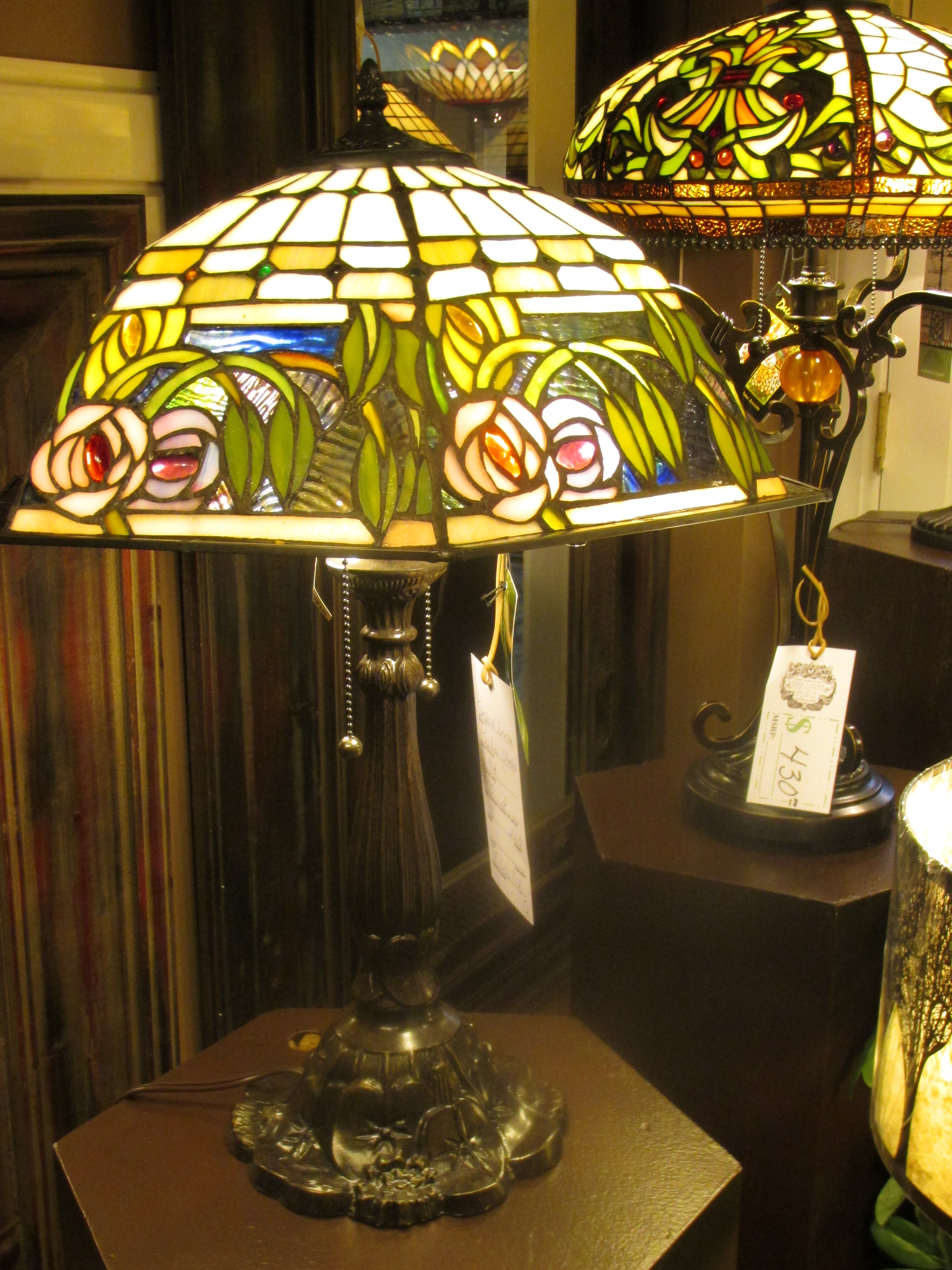 Stained glass Tiffany table lamp incorporates Radiant Orchid with sophistication and style. Visit The Light Place for all your indoor and outdoor lighting needs.
