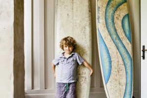 Eight-year-old Max ready to hit the beach in search of his next wave.