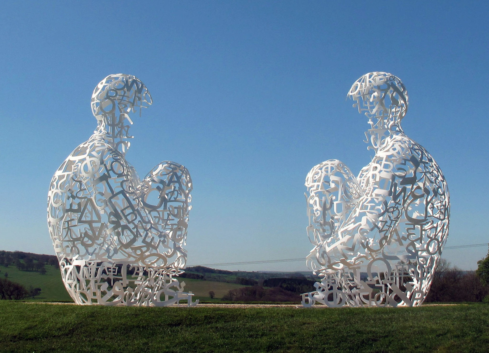 SPIEGEL 2010, Painted stainless steel, 148.4 x 92.5 x 96.5 inches (each): © Jaume Plensa. Courtesy Galerie Lelong, New York