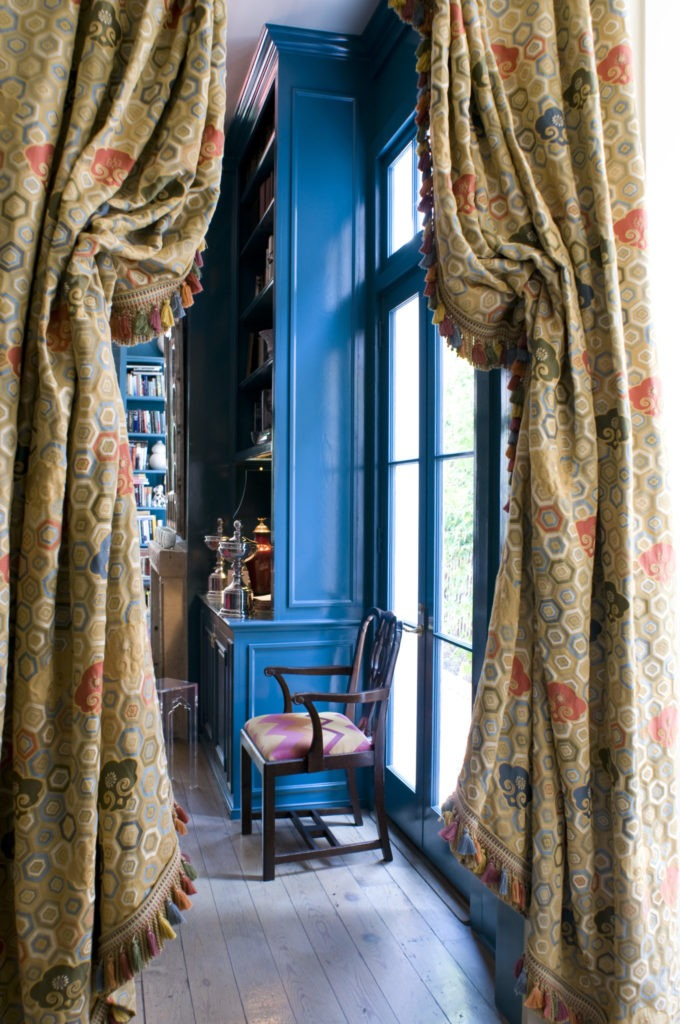 "Clarence House's ""Etro"" fabric flanks the doors to the library and carries the color scheme into the den."