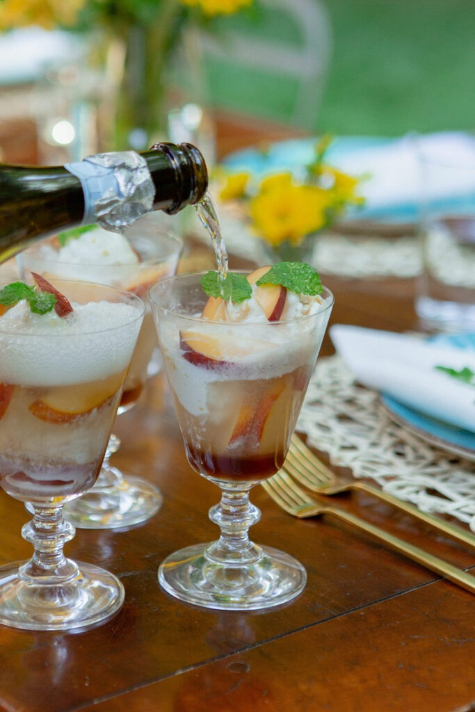 summer entertaining al fresco dining peach cassis champagne floats